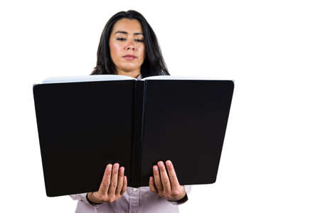 ledger: Businesswoman holding a business ledger against a white background Stock Photo