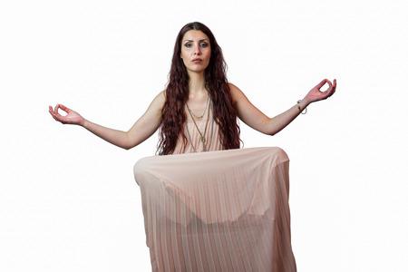 levitating: Portrait of woman levitating against white background