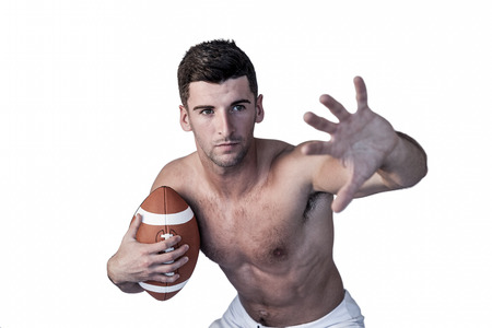 over white background: Shirtless rugby player defending over white background