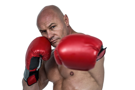 fighting stance: Portrait of boxer with fighting stance against white background Stock Photo