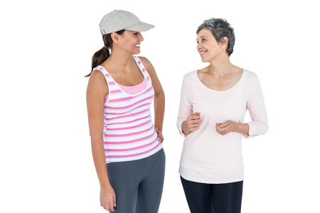 fit women: Happy fit women discussing against white background