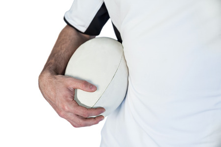 rugby ball: Midsection of player holding rugby ball over white background Stock Photo