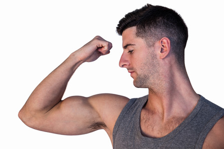 over white background: Handsome man showing biceps over white background