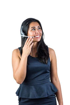 call out: Smiling woman wearing her headset against a white background Stock Photo
