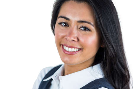 young adult woman: Close up of a smiling woman against a white background