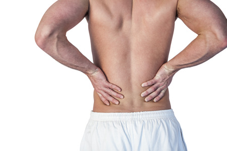 dreariness: Midsection of man undergoing back pain over white background