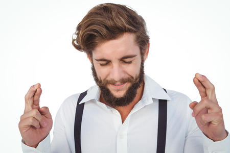 fingers crossed: Hipster with fingers crossed against white background Stock Photo