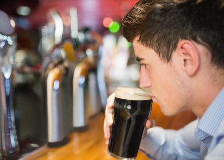 bar counter: Close-up of man with drink at bar counter Stock Photo