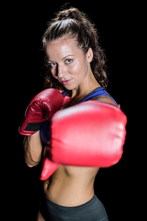 fighting stance: Portrait of athlete with fighting stance against black background