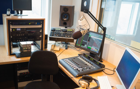 Modern equipment on desk in radio studio Stock Photo