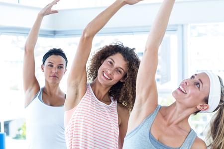 arm raised: Women with arm raised in fitness studio Stock Photo