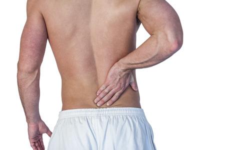 dolor espalda: Sección media de hombre que sufre de dolor de espalda sobre el fondo blanco Foto de archivo