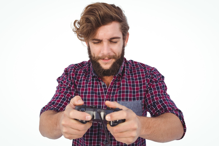 playing video game: Hipster playing video game against white background