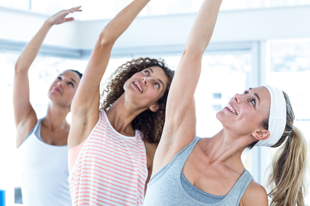 arm raised: Sporty woman with arm raised in fitness Stock Photo