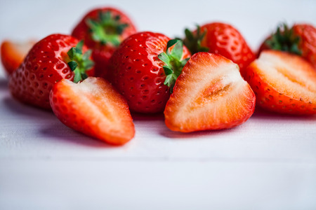 halved  half: Fresh strawberries in close up on wooden table