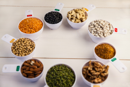 a portion: Portion cups of healthy ingredients on wooden table