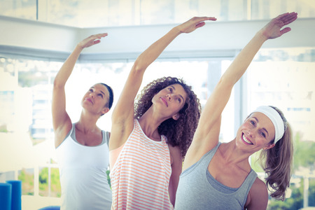 arm raised: Sport women with arm raised in fitness studio
