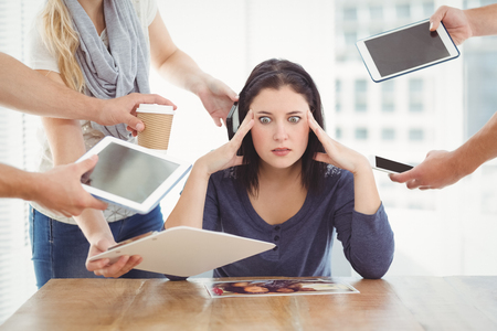 Businesswoman having headache while sitting at desk