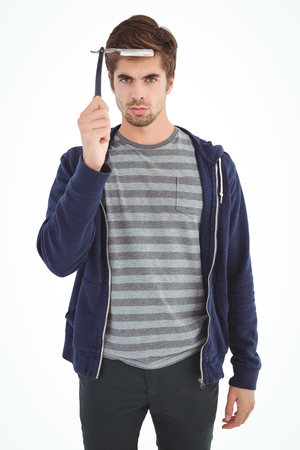 straight man: Portrait of man with straight edge razor against white background