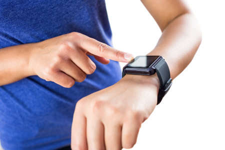 cut wrist: Woman using her new smartwatch  against a white background