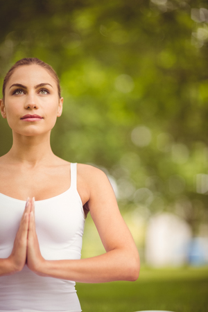 hands clasped: Confident woman with hands clasped while standing in park