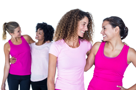 arms around: Happy women with arms around while standing against white background Stock Photo