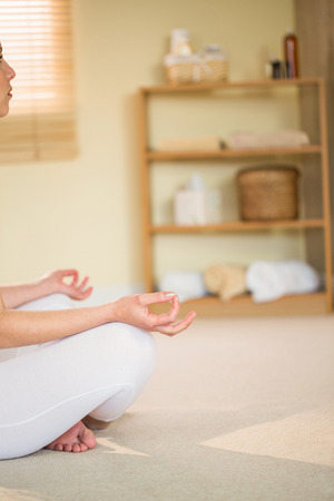 cropped: Cropped woman in yoga pose while sitting on floor