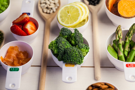 lima bean: Portion cups of healthy ingredients on wooden table