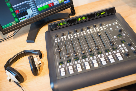 sound mixer: High angle view of sound mixer on desk in radio station