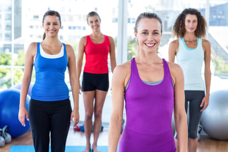 fit women: Fit women posing and smiling in fitness studio