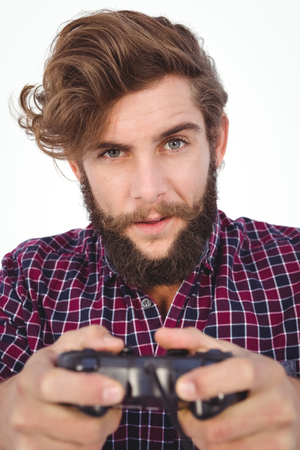 playing video game: Portrait of hipster playing video game against white background