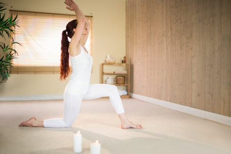 manos unidas: Side view of woman meditating with joined hands at spa