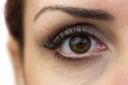 sensory perception: Close-up portrait of woman eye against white background Stock Photo