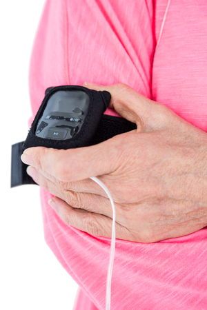mp3 player: Cropped image of woman holding mp3 player on armband against white background Stock Photo