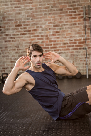 crunches: Man doing crunches at the gym Stock Photo