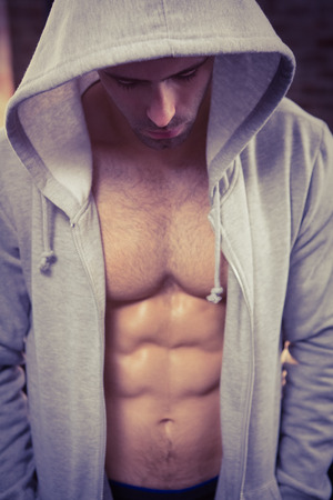 macho man: Handsome man wearing hood at the gym