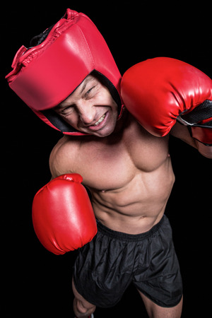 headgear: High angle view of boxer with headgear and gloves against black background