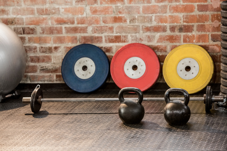 gym room: Exercising equipment arranged at the gym Stock Photo