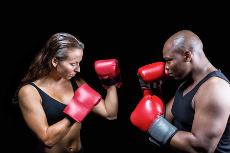 fighting stance: Athletes with fighting stance against black background