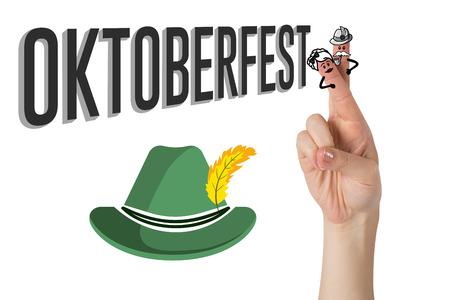 german alcohol: Oktoberfest character fingers against oktoberfest graphics