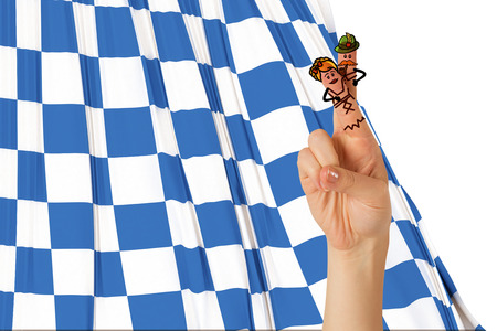 german culture: Oktoberfest character fingers against blue and white flag