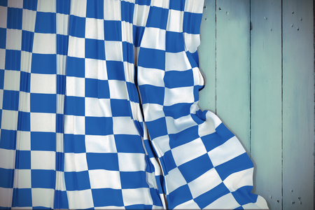 checker flag: Blue and white flag against wooden planks