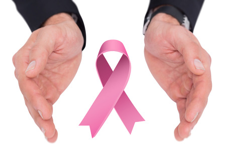 cancer spread: Close up of businessman with hands spread on the floor against breast cancer awareness ribbon