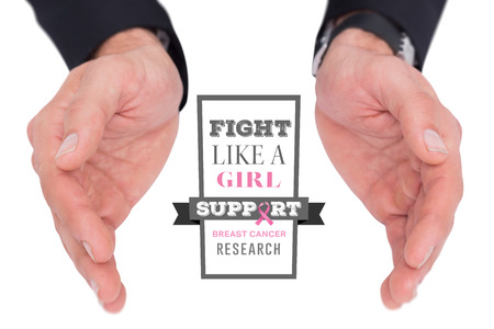 cancer spread: Close up of businessman with hands spread on the floor against breast cancer awareness message
