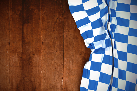 checker flag: Blue and white flag against weathered oak floor boards background