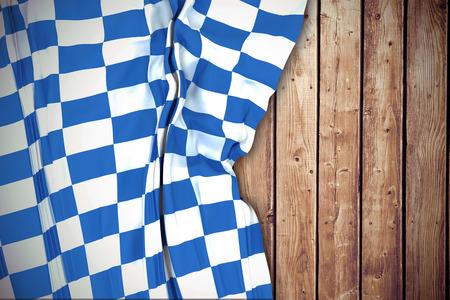 checker flag: Blue and white flag against wooden planks background Stock Photo