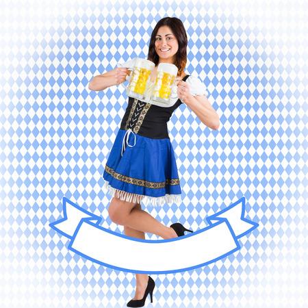 tankard: Pretty oktoberfest girl holding beer tankards against blue pattern Stock Photo