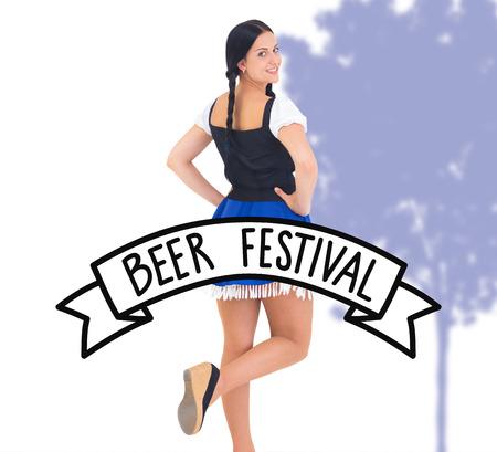 beer festival: Pretty oktoberfest girl smiling at camera against beer festival banner
