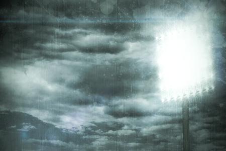 spotlight: Spotlight against cloudy sky