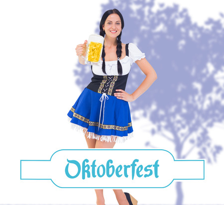 tankard: Pretty oktoberfest girl holding beer tankard against oktoberfest banner Stock Photo